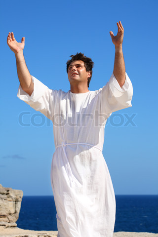 2704368 398590 a man dressed in white robe with hands raised in spiritual devotion praise or happiness
