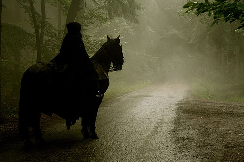 Cloaked rider