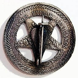 Five peso badge